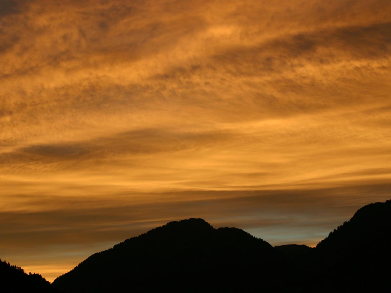 Omgeving - Wolken en ondergaande zon